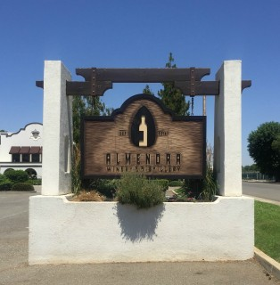 The welcome sign Almendra Winery & Distillery in Durham, CA.